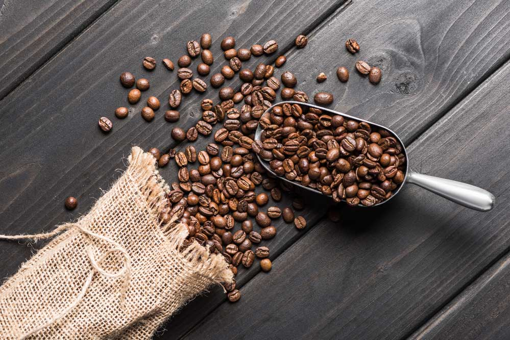 Coffee beans getting measured for freezing