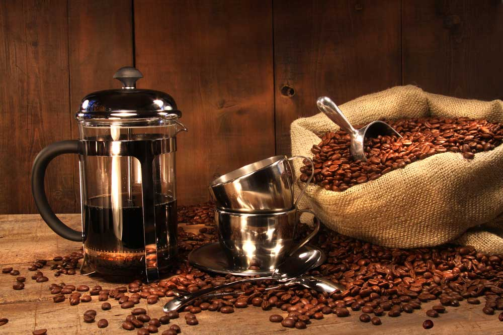French Press Coffee with beans abou to be brewed for the right length of time