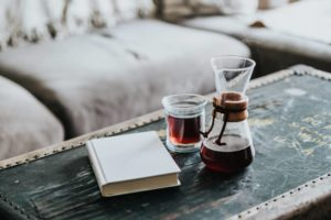A Chemex of coffee and a book at home