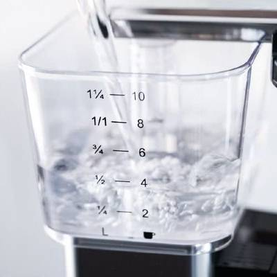Filtered Water Being Poured into a Moccamaster