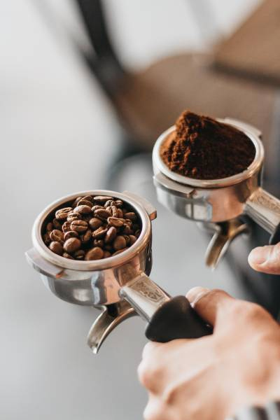 Some coffee beans in a coffee cup