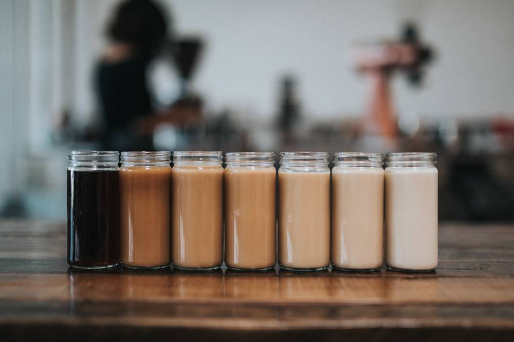 A gradation of milk in coffees