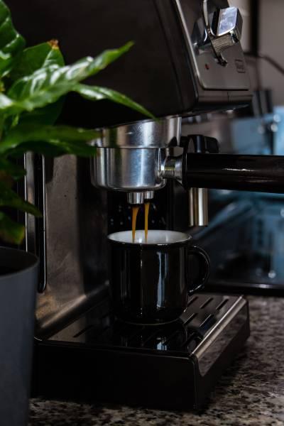 An Espresso Machine pouring an espresso shot