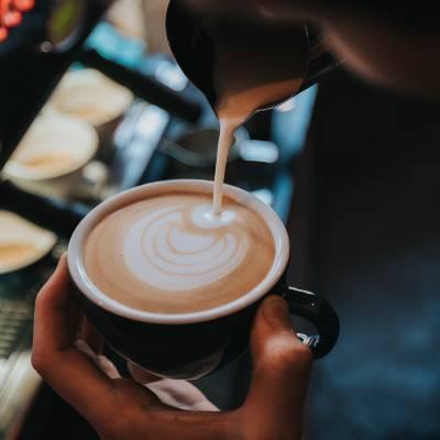 A Barista making a latte