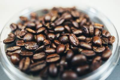 a close up of coffee beans in a jar