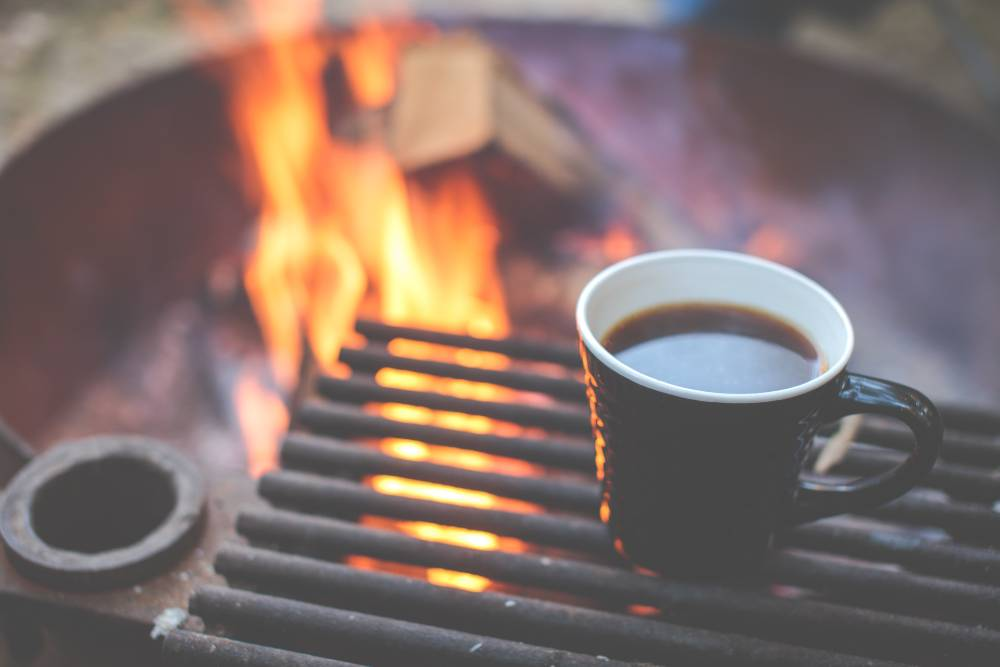 coffee by a camp fire