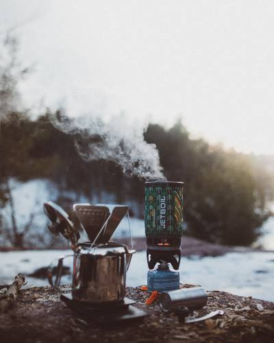 pour over coffee brewing while camping