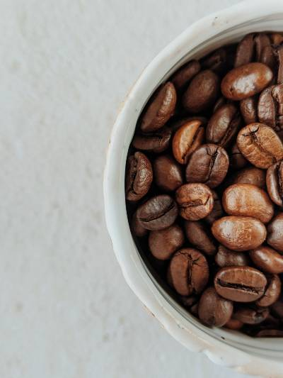 some coffee beans in a cup