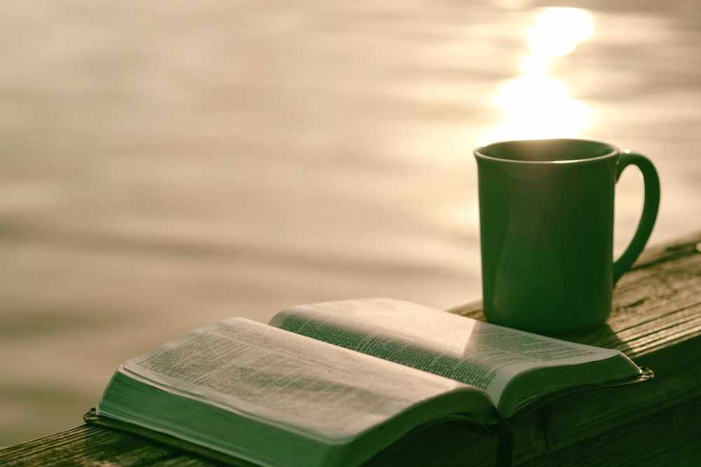 A Mug of Coffee and a Book by The Sea