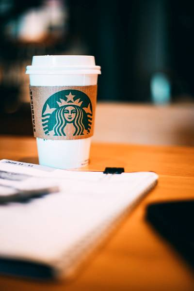 A Starbucks cup on a desk