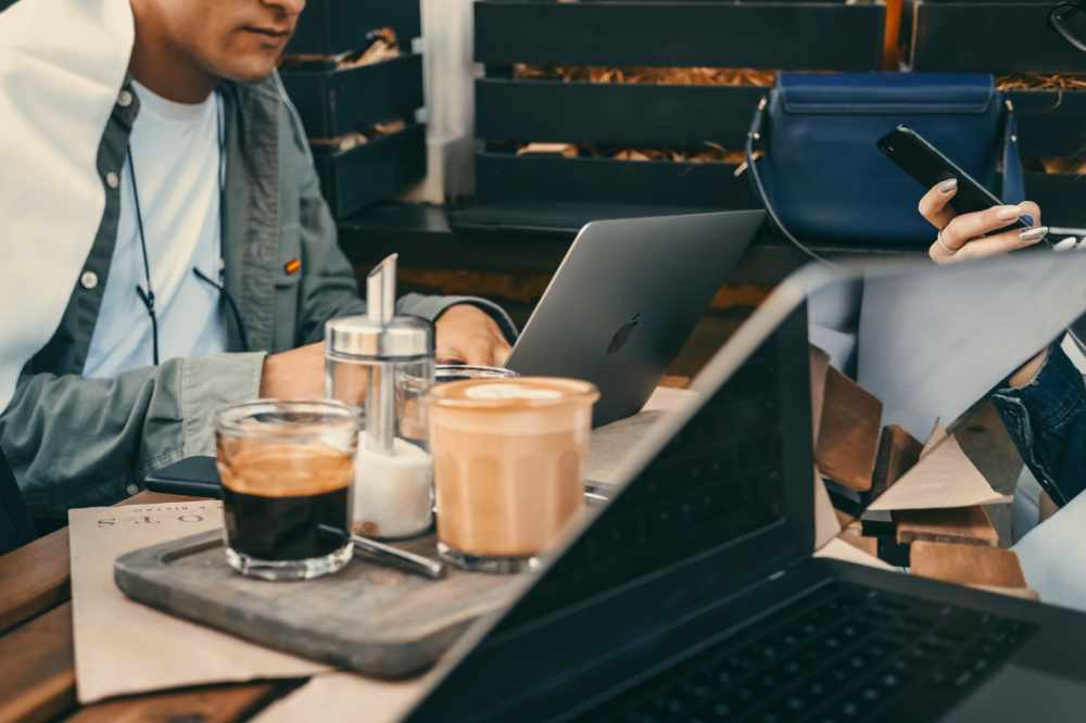 Some people working and enjoying coffee