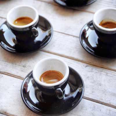 Three espresso shots on a table
