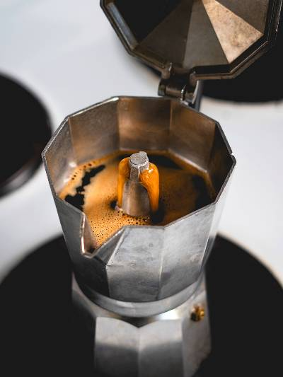 A Moka Pot Flowing with Freshly Brewed Coffee