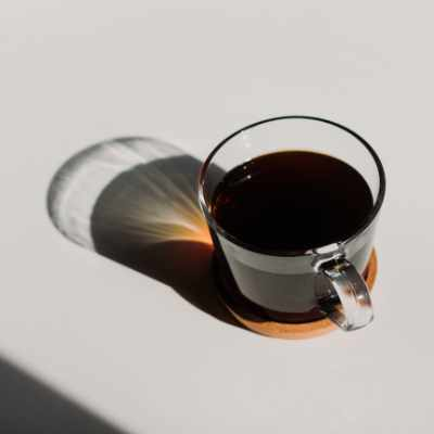 A cup of black coffee left sitting out