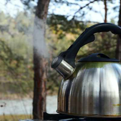 A kettle boiling on a gas stove