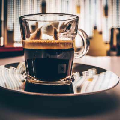 A cup of coffee in a Nespresso mug