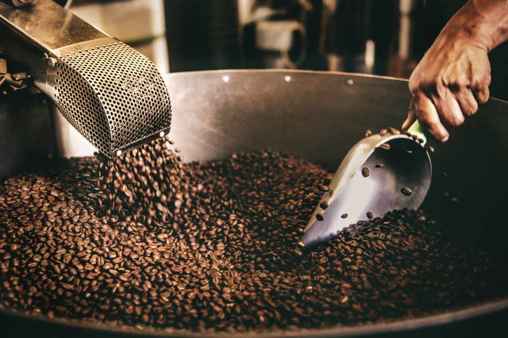 Coffee beans being blended