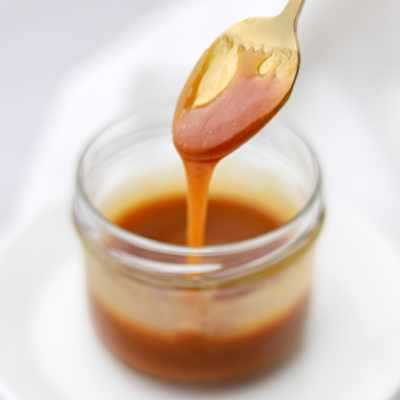 caramel syrup dripping from a spoon