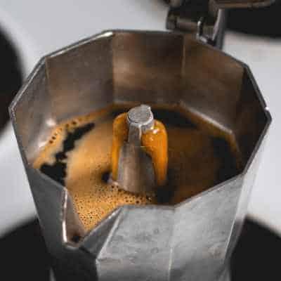 Coffee bubbling up through a Bialetti Moka Express