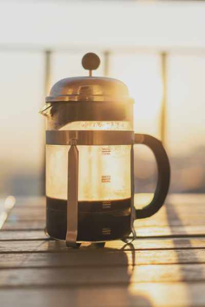 A Bodum Chambord French Press with the sun shining through it
