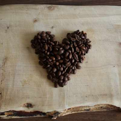 Caprissimo Italiano Coffee Beans in a love heart on wood