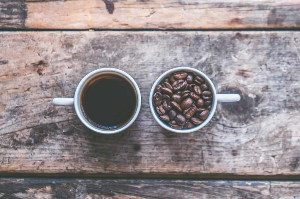 a cup of coffee and a cup of coffee beans